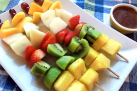 Fruit kebabs with warm chocolate sauce